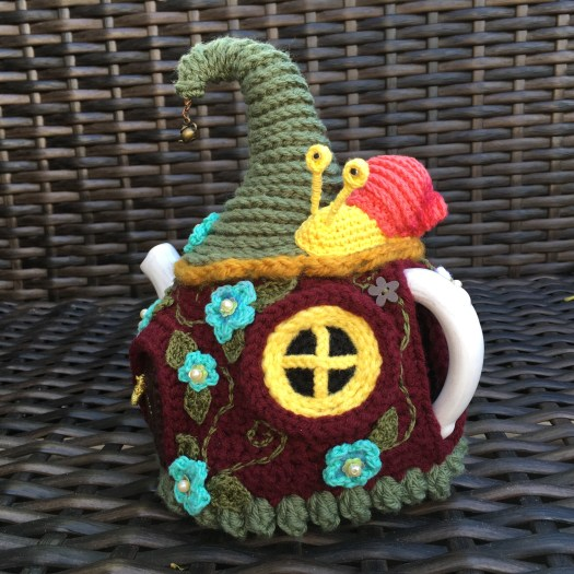 Amazing Crocheted Fairy House Tea Cosy made by #craftevangelist #crochet #crafts #yarn #diy #fairyhouse #teacosy