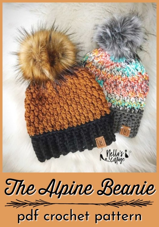 The Alpine Beanie is a gorgeous textured crochet hat pattern. I love this stitch pattern and the giant faux fur poms on top! #crochetpattern #crochethat #hatpattern #yarn #crafts #crochet #craftevangelist