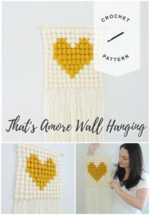 Adorable crochet bobble stitch crochet pattern for this heart wall hanging, perfect for the nursery. I need one in this mustard colour! #crochetwallhanging #bohowallhanging #macrame #macramewallhanging #crochetwalldecor #crochetpattern #craftevangelist