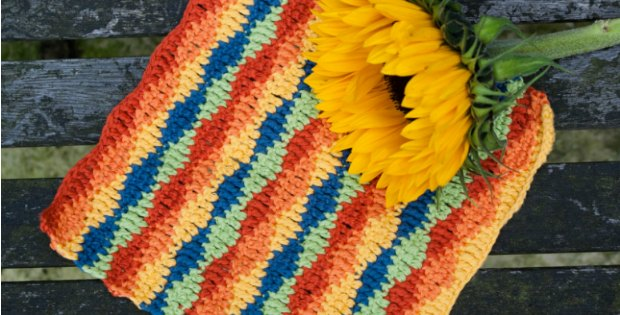 Pretty crochet pattern for a lazy waves dishcloth to bring some color to your dishes!