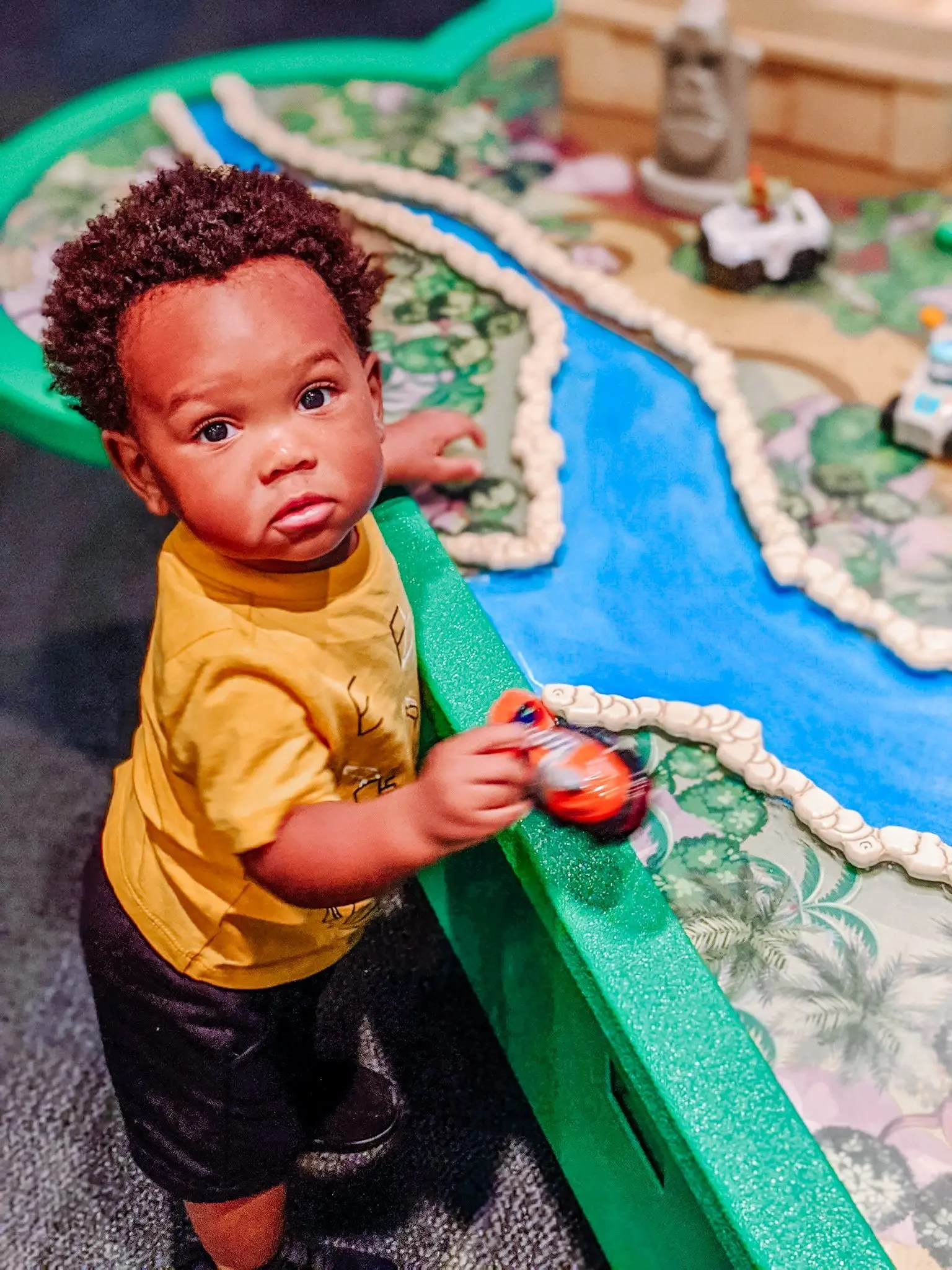baby at sensory table at the museum