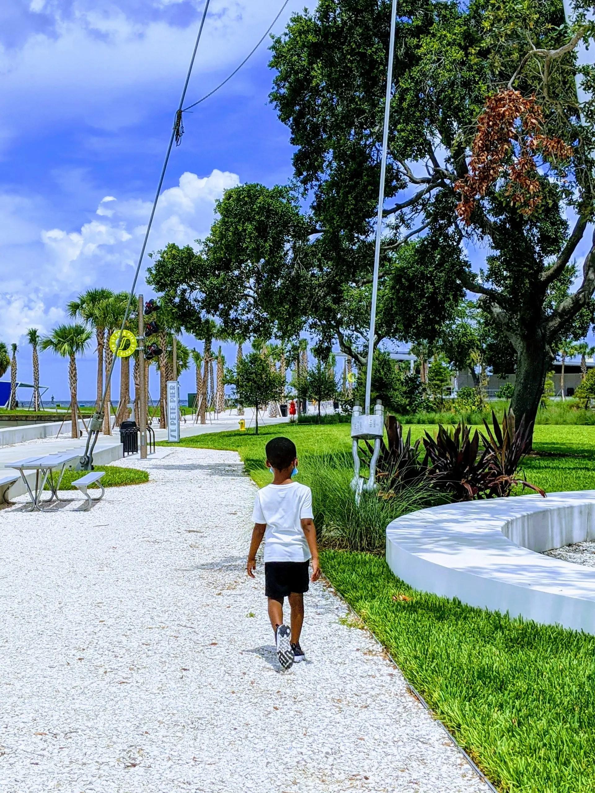 Black boy exploring the pier