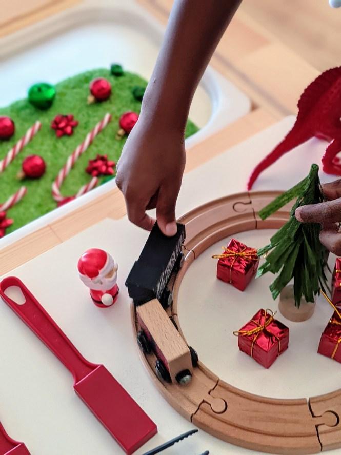 Dinosaur Christmas sensory bin for kids