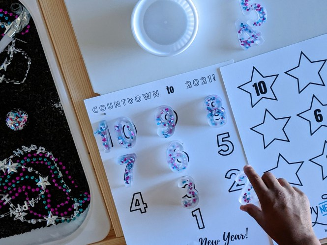 New Year's Sensory Bin with free printable for kids