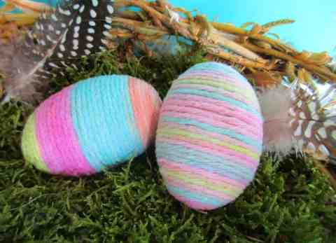 These pretty string wrapped eggs are perfect for Easter decorations, and are quick and easy to make without having to use messy glue. Please click through for full instructions.