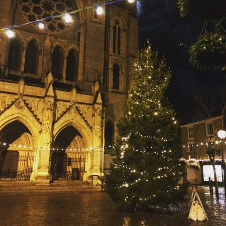 Truro Cathedral behind the lit Christmas tree