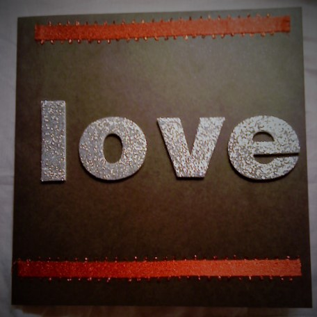 Glitter LOVE card with red ribbon, on black card. - Jewels and Sparkle