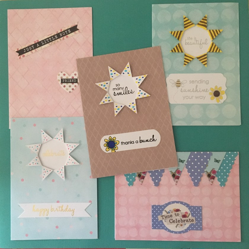 Five handmade happy mail cards in pink, turquoise, blue and brown