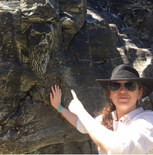 The Face of Merlin (Kay) pointing the carving of Merlins face out on the cliffside