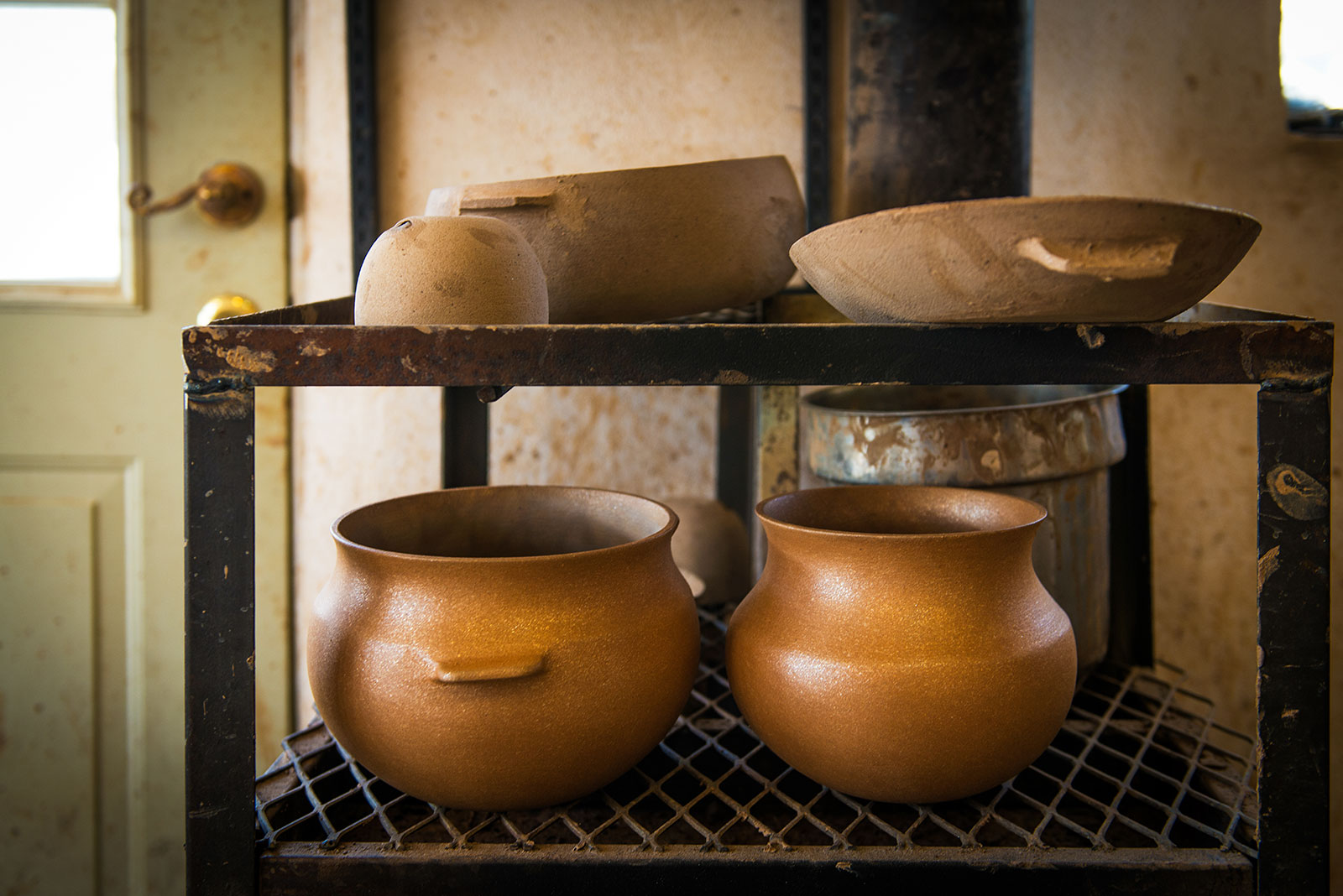 Even before an Ortega pot is fired it begins to glow, due to its myriad flecks of mica. For a complete portrait of Ortega's work as it progresses, see this photo essay.