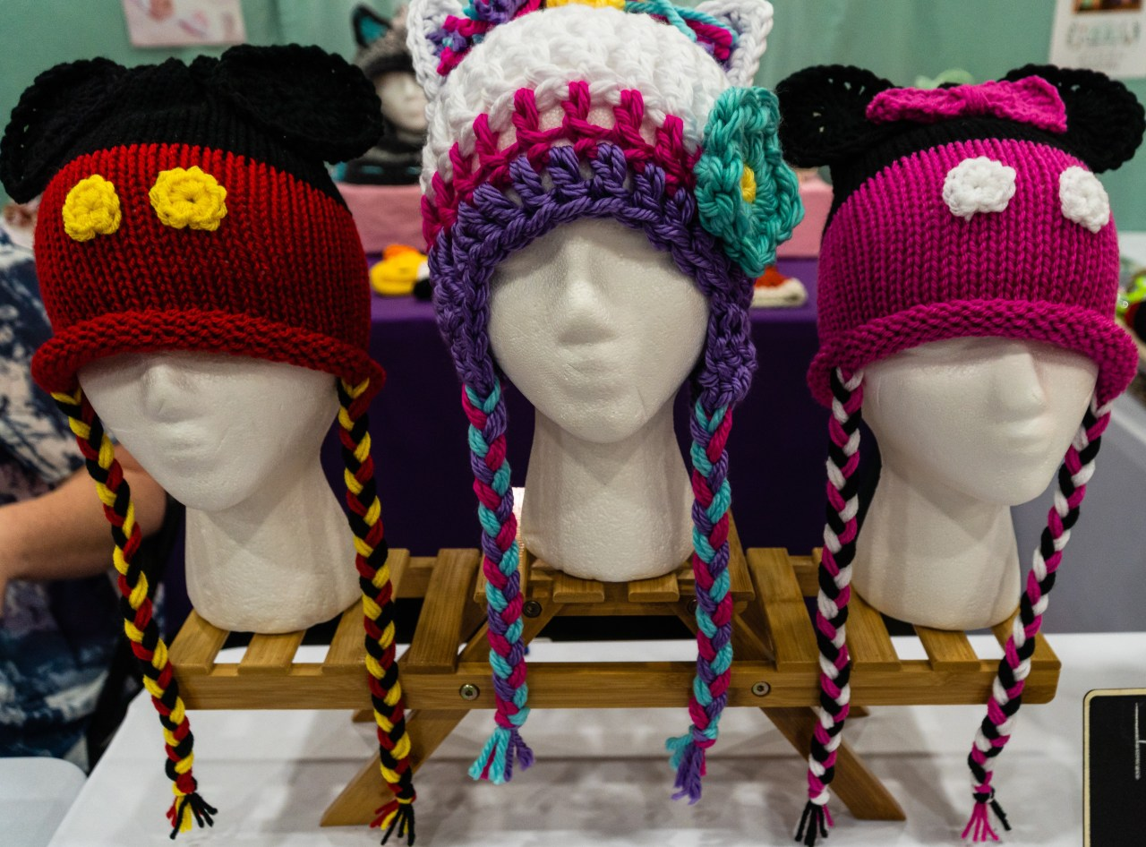 Whimsical knit hats on display