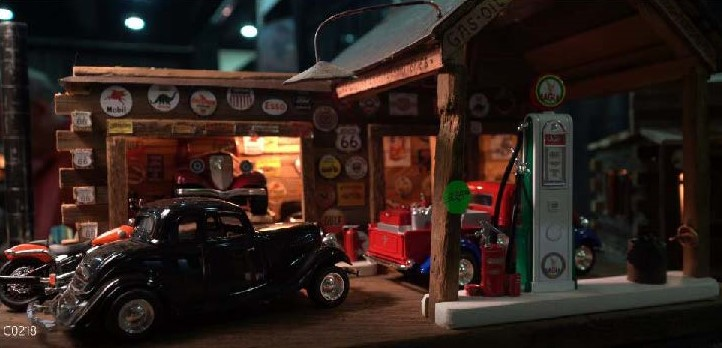 Miniature Scene of a Filling Station with Cars
