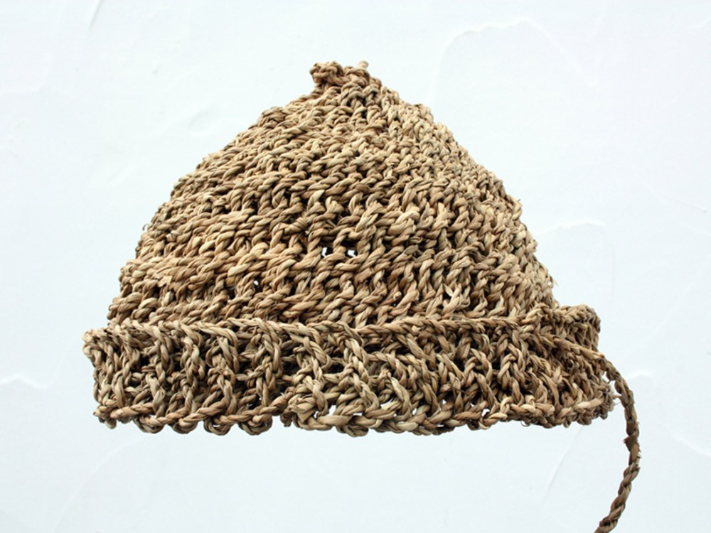A hat woven from brown straw string.