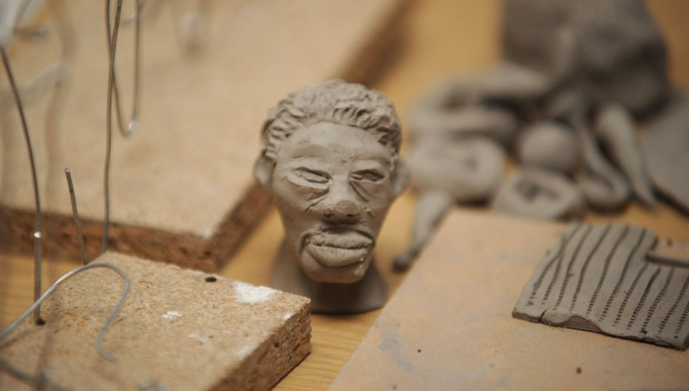A face modelled out of a small amount of clay.