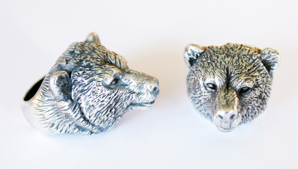 silver rings decorated with detailed heads of bears.
