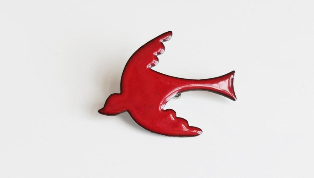 red enameled bird brooch. simple in design.