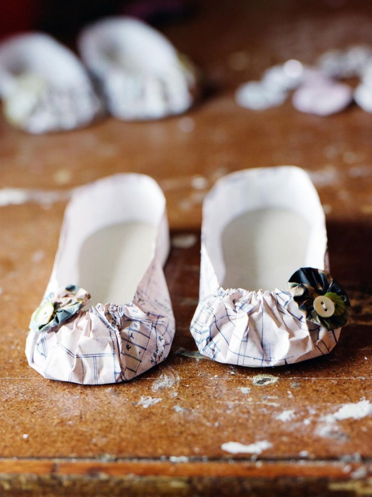 Shoes made out of paper and buttons.