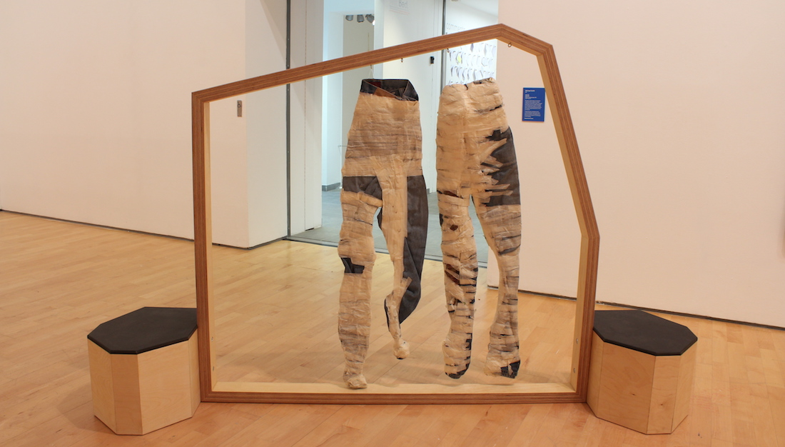 jeans with tape wrapped round them displayed in the gallery