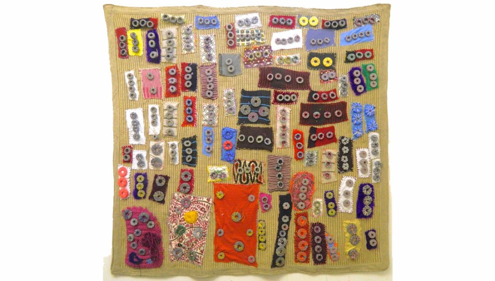 textile artwork with colourful rectangles and circles