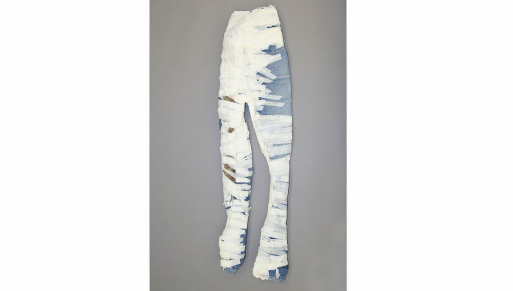 jeans with masking tape wrapped around them