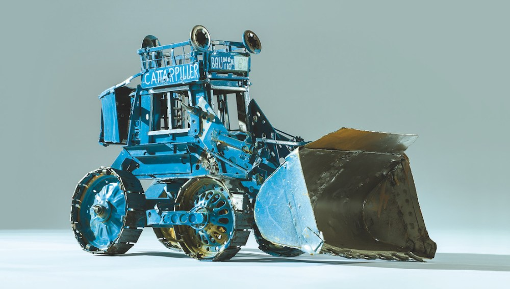 model sculpture of a digger made from reclaimed metal