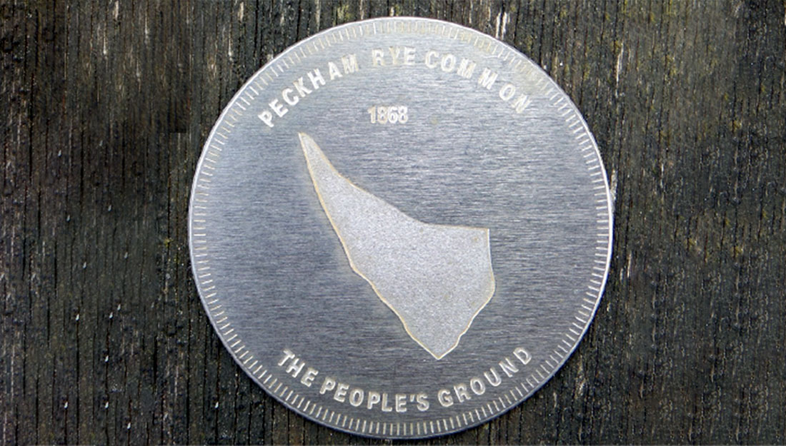 A silver token, like a big coin.