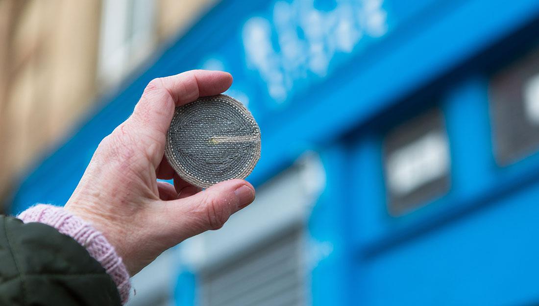 A small embroidered circular token