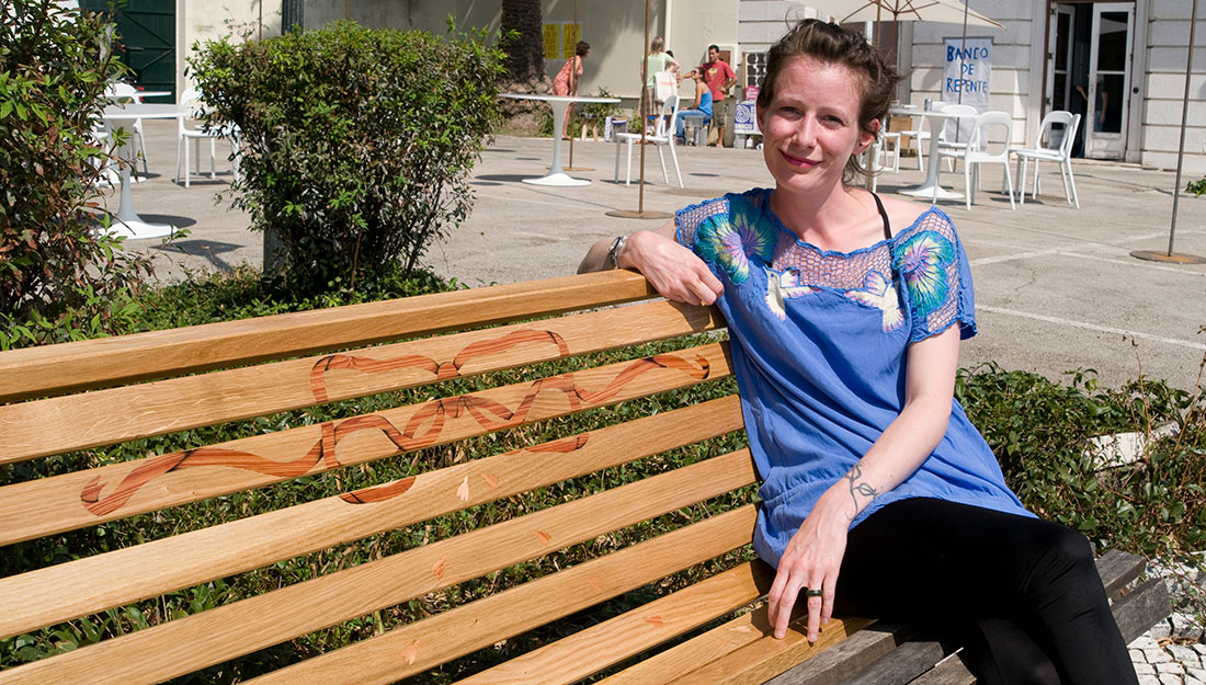 The artist on a repaired bench.