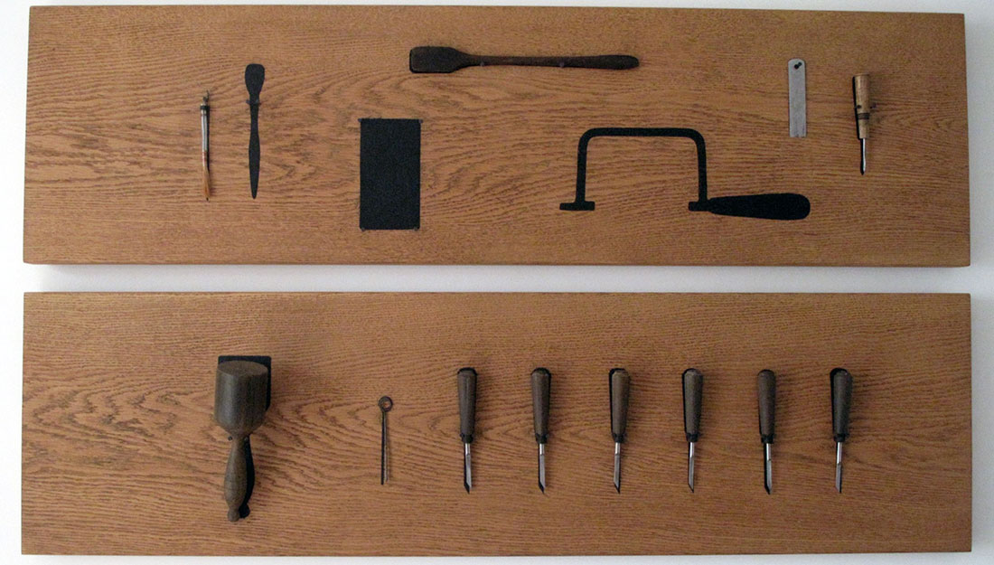 A tool shadowboard, with handmade tools.