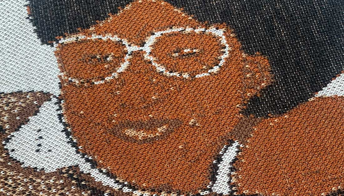 A close up of an embroidered face.