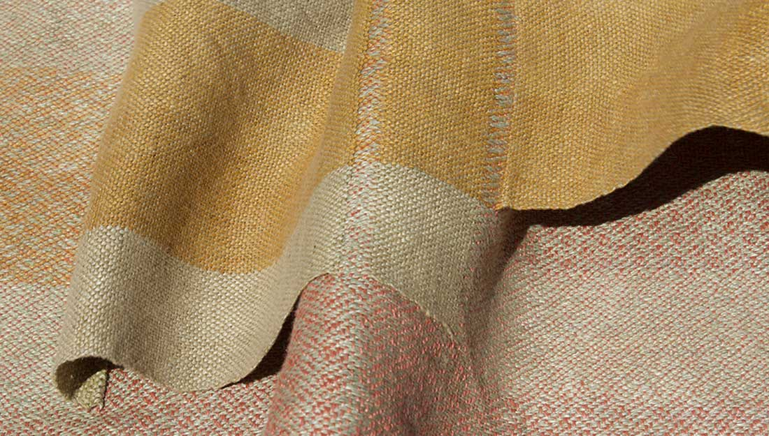 A woven fabric with muted natural tones.