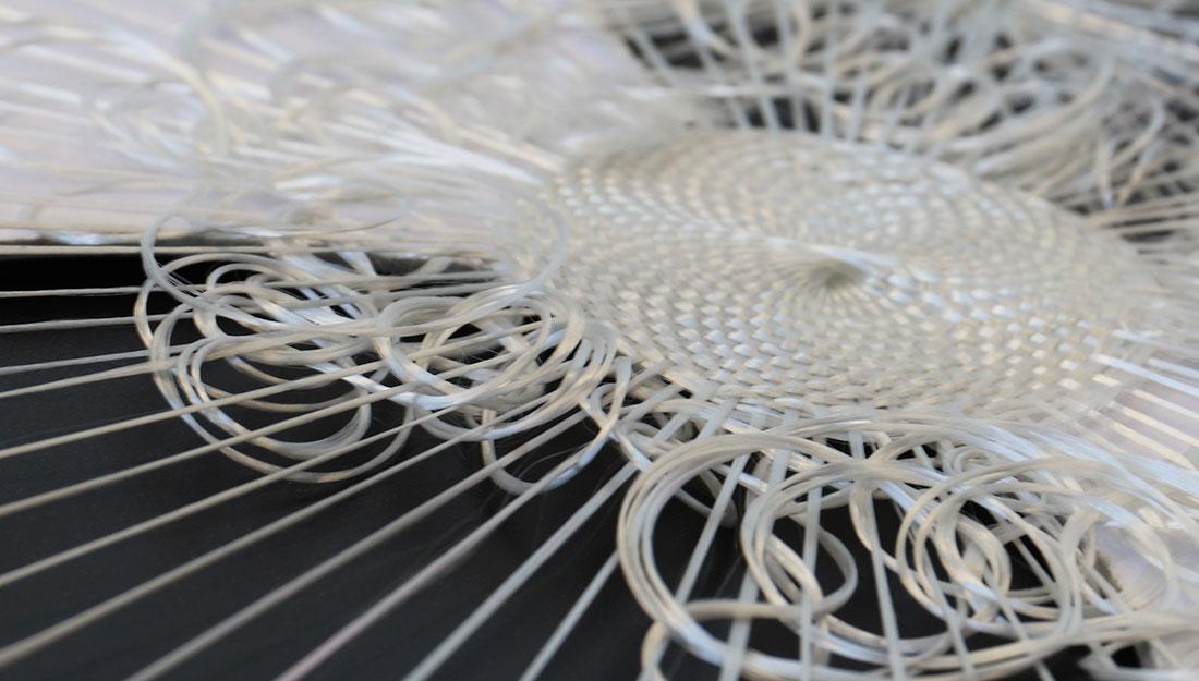 A delicate woven piece in progress.
