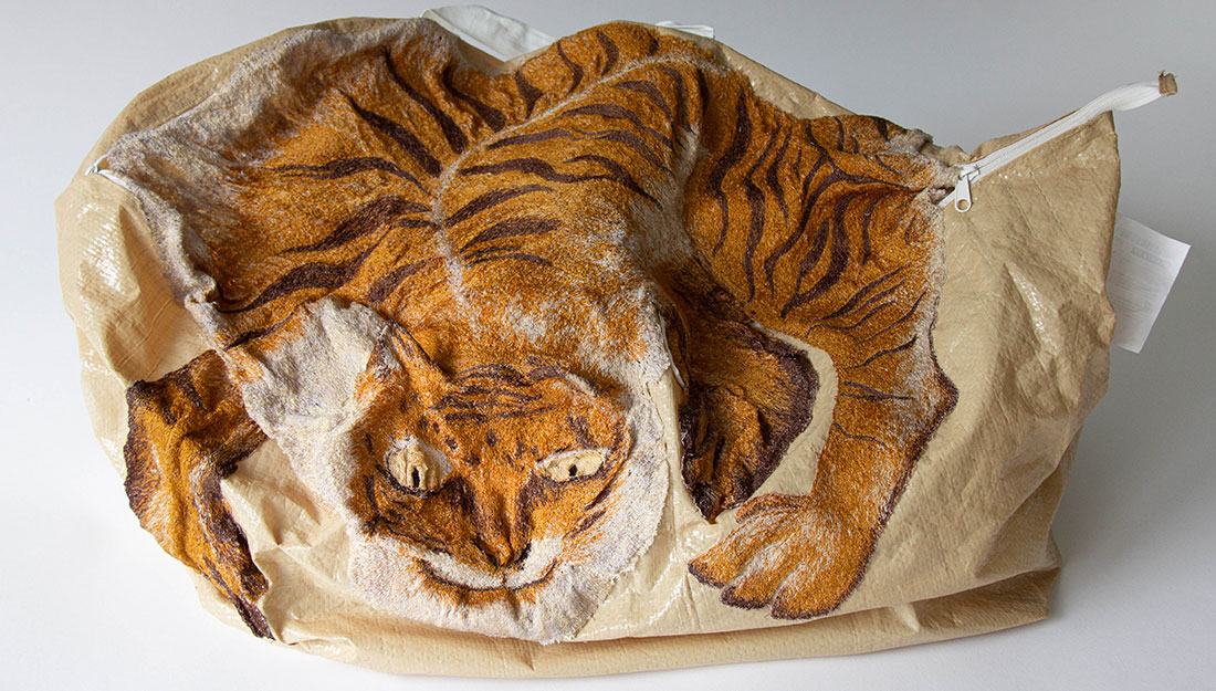 A bag embroidered with a large detailed tiger.