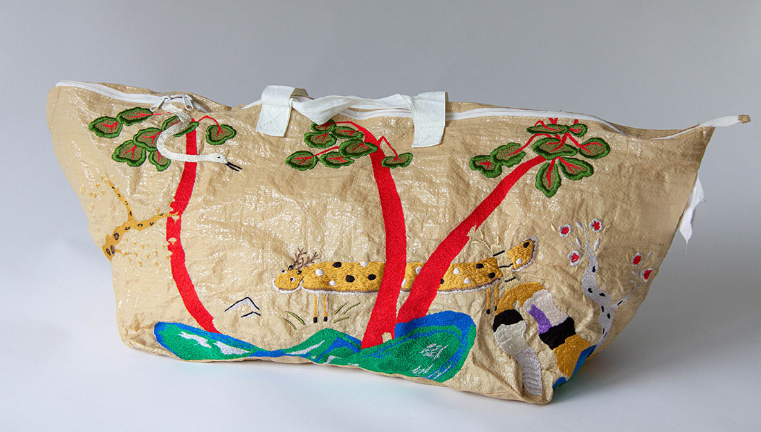 A large embroidered bag.