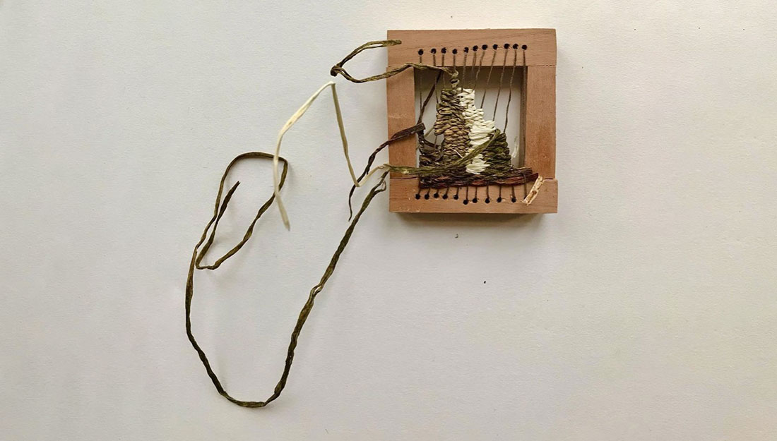 foraged items woven on a small frame.