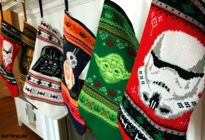 Star Wars stockings hung on a mantel as part of Star Wars Christmas Decorations