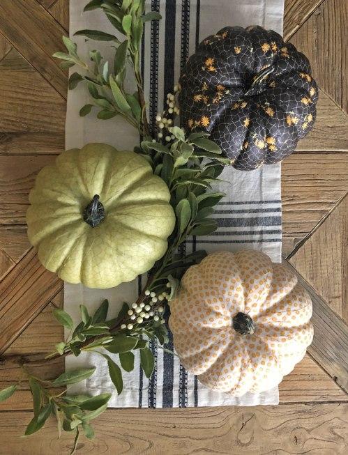Glue fabric onto pumpkins for a gorgeous fall centerpiece