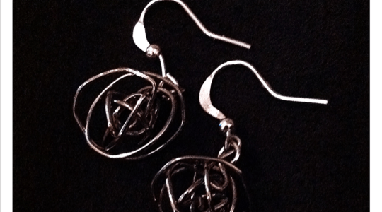 silver earrings with wire ball pendants