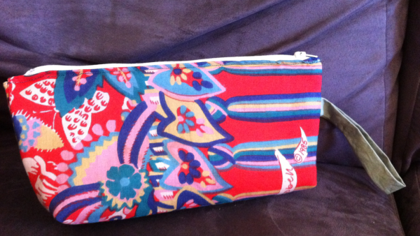 bright red patterned clutch made from an old scarf