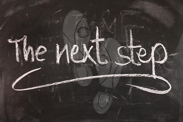 Blackboard saying 'The Next Step'