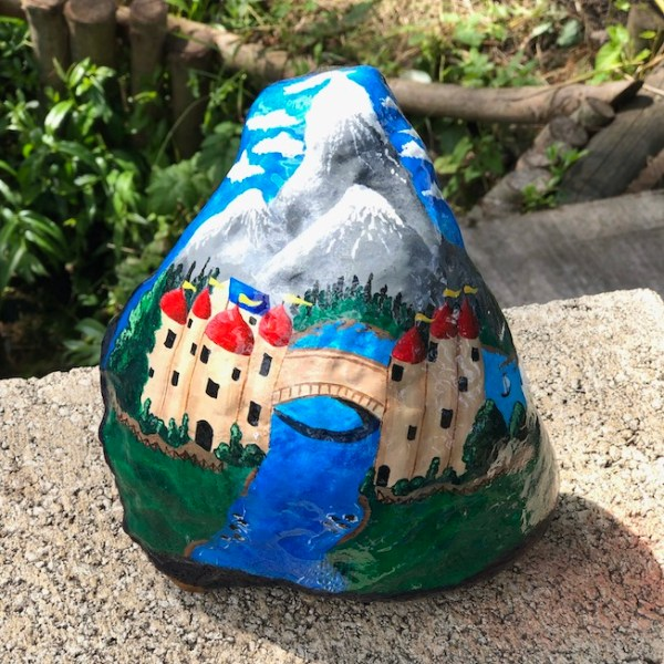 Natural rock painted with traditional canal art design