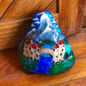 Natural rock painted with traditional canal art design as door stop