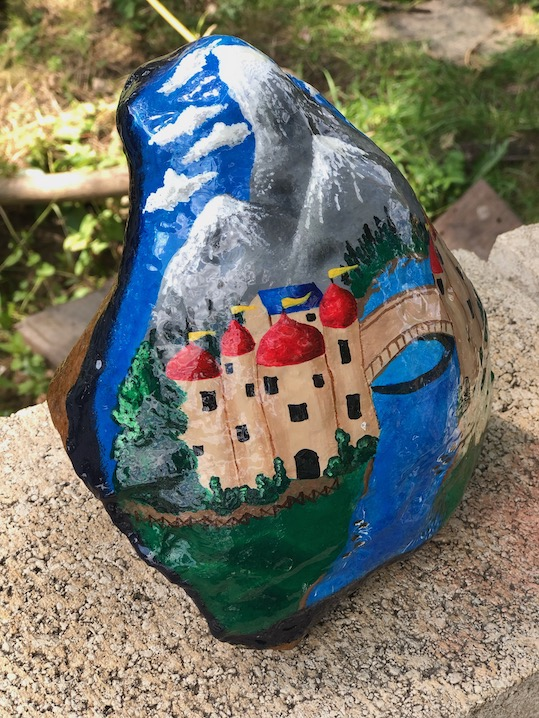 Natural rock painted with traditional canal art design right side view