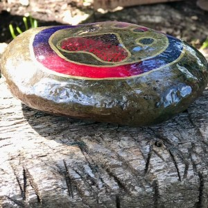 Natural rock with animal paw design in purple and pink side view