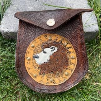 Leather tooled sporran Lion