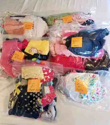 Clothes in bags ready for storage