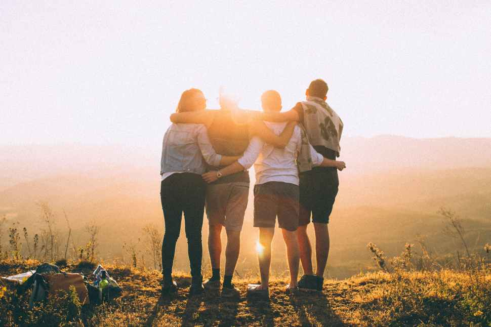 Group hugs at sunset