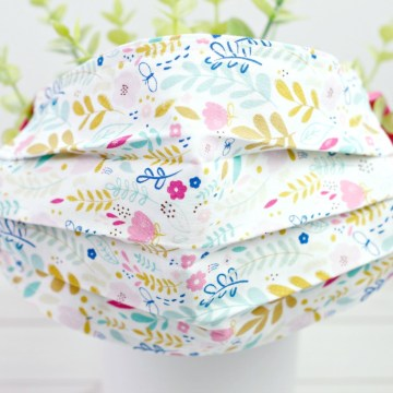 front view of a hand sewn floral fabric pleated face mask