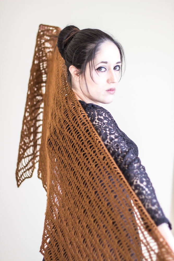 Summer Solstice Stole Crochet Pattern. The stole is worked seamlessly from side to side, using a combination of chain and double crochet stitches.