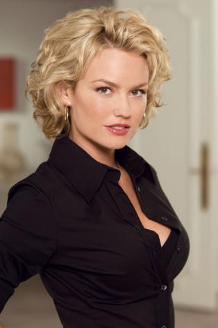 Kelly Carlson as the new madame